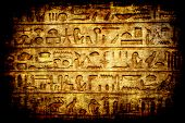 stock photo of hieroglyph  - Ancient dark stone with egyptian hieroglyphs - JPG