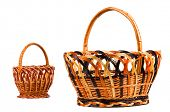 Traditional wicker baskets isolated on white background. Focus on the big basket.
