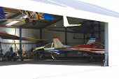 picture of ultralight  - open hangar with a few ultralight airplanes inside - JPG