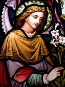 stock photo of archangel  - Stained glass in Catholic church in Dublin showing Archangel Gabriel - JPG