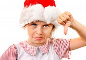 Displeased Little Girl In Santa Hat Make Thumb Down On The White Background poster