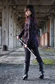 stock photo of revelation  - Dangerous asian girl with katana in ruins - JPG