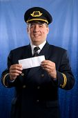 smiling pilot with ticket