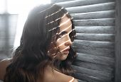 Fashion Woman With Makeup And Curly Hair. Beauty And Fashion Look. Sensual Woman With Makeup At Wind poster
