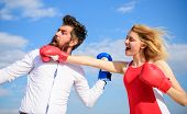 Relations As Struggle Concept. Man And Woman Fight Boxing Gloves Blue Sky Background. Defend Your Op poster