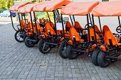 Many Fashionable Orange Four-wheeled Sports Bicycles, Cycle Cards For Family Sports Recreation And T poster