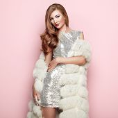 Fashion Portrait Young Woman In White Fur Coat. Girl With Elegant Hairstyle Posing On A Pink Backgro poster