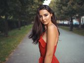 Fashion Sensual Woman Portrait. Outdoor Photo Of Attractive Brunette Model In Red Dress. Gorgeous Br poster