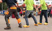 RAUBICHI, BELARUS - AUGUST 24: Loggers in round dance on opening ceremony during World Logging Champ