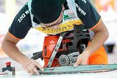 RAUBICHI, BELARUS - AUGUST 25: Japanese Hiroki Shirakawa fits another chain during World Logging Cha