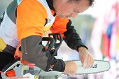 RAUBICHI, BELARUS - AUGUST 25: Peter Fox from United Kingdom fits another chain during World Logging Championship in Raubichi, Minsk region, Belarus at August 25, 2012