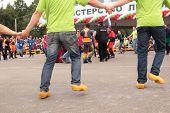 RRAUBICHI, BELARUS - AUGUST 24: Loggers in round dance on opening ceremony during World Logging Cham