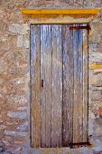Aged grunge wood door stripes texture weathered in mediterranean sea