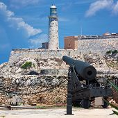 The castle of El Morro, a symbol of Havana, with an old spanish cannon on the foreground