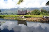 stock photo of minangkabau  - Lake Toba and house on SAmosir island - JPG