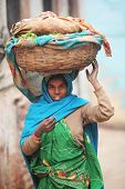 Indian Women In National Clothes With Basket