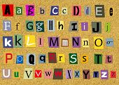 Colorful Alphabet Letters over cork background