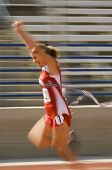 image of won  - Blurred motion of excited female athlete runner crossing the finishing line - JPG