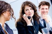Businesspeople Calling On Phone