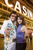 Woman standing with Elvis impersonator