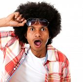 stock photo of unawares  - Surprised black man taking a good look  - JPG