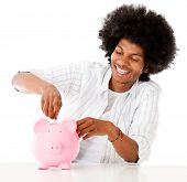 Black man saving in a piggybank - isolated over a white background