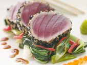stock photo of yellowfin tuna  - Seared Yellow Fin Tuna with Sesame Seeds Sweet Fried pac Choi and Salmon Roe - JPG