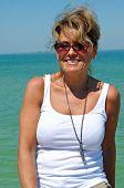 Attractive Woman On Beach Boardwalk