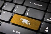 image of keypad  - Transport delivery key with truck icon on laptop keyboard - JPG