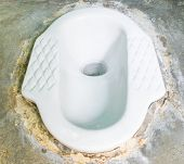 Ceramic Lavatory With Septic Tanks On Cement Floor.