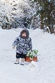 little girl in a winter wood