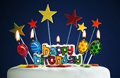 stock photo of candle flame  - Happy birthday candles and balloons burning on a cake - JPG