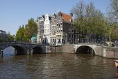 Amsterdam, Netherlands - Arch Of Bridges And Old Houses