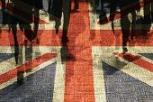 Conceptual image of shoppers overlaid onto UK flag.