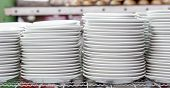 Stacks Of White Plates In Warehouse
