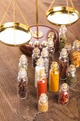 stock photo of vedic  - Little bottles with spices and scales on the table vedic cuisine - JPG