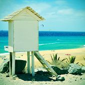 picture of a lifeguard tower in Sotavento Beach in Fuerteventura, Canary Islands, Spain, with a retro effect
