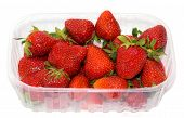 stock photo of picking tray  - transparent plastic tray with freshly picked strawberries - JPG