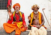 KATHMANDU, NEPAL - MAY 18: Holy Sadhu men with traditional painted face, blessing in Pashupatinath T