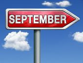 September pointing to next month of the year summer road sign arrow