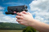 Woman's Hand Holding Gun