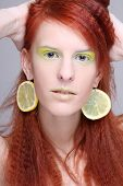 Portrait Of Woman With Lemon Slices In Ears