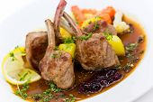 stock photo of lamb chops  - Close up picture of a roasted lamb chop - JPG