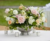 flower arrangement in silver bowl with pink and white roses