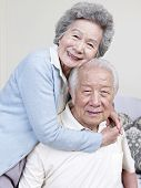 picture of snuggle  - portrait of a loving senior asian couple - JPG