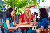 Three Beautiful Girls Sitting On Cafe Terrace