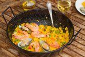 Seafood paella in black pan