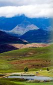 foto of zulu  - Mountains and wide valleys characterize the Drakensburg area in Kwa - JPG