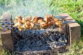 Shish Kebab On The Improvised Oven Made Of Brick