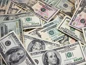 stock photo of money stack  - A pile of money in mixed denominations - JPG